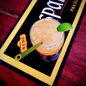 Rum punch with natural bamboo straw