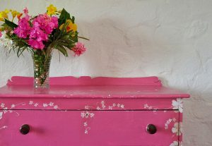 Baliceaux Pink Dresser with flowers on top